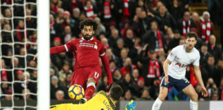 Salah squeezes the ball past Hugo Lloris