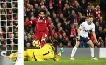 Salah squeezes the ball past Hugo Lloris